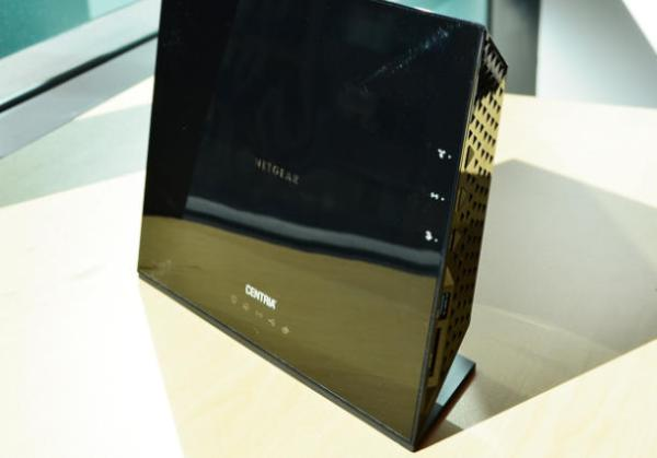 Thirteen popular routers including the Netgear Centria WNDR4700 pictured here were tested and found vulnerable to hacks in a new study by research firm Independent Security Evaluators. (Credit: Dong Ngo/CNET)